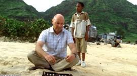 Locke teaching Walt how to play backgammon.